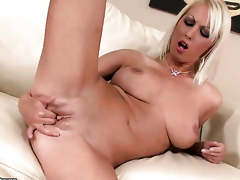 Blonde Pamela Blond with racy hooters fucks herself with toy