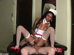 Bootilicious shemale nurse rides her lover's cock down to the base