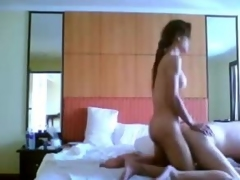 Titty tranny fucks a guy on a bed